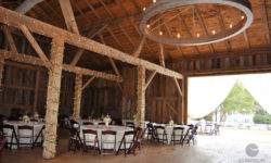 Barn interior with table settings. Picture courtesy of 45 Parallel Consulting LLC.